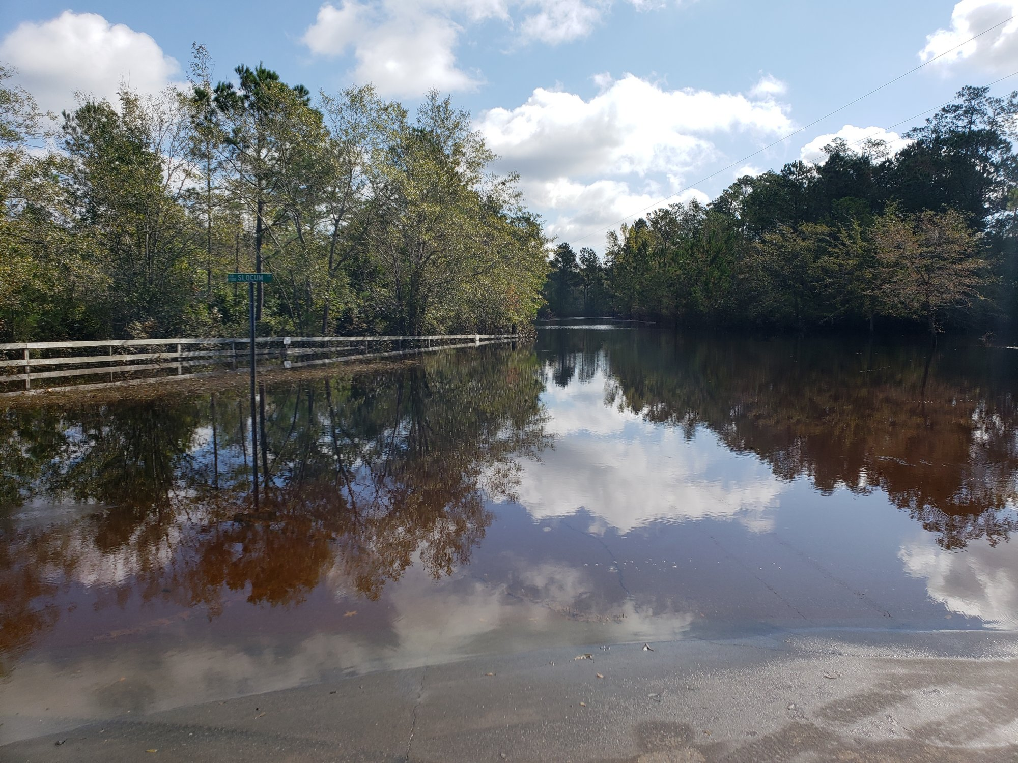 Flooding at Battleground Rd and Slocum Trail near Moores Creek in Currie, Pender County, NC