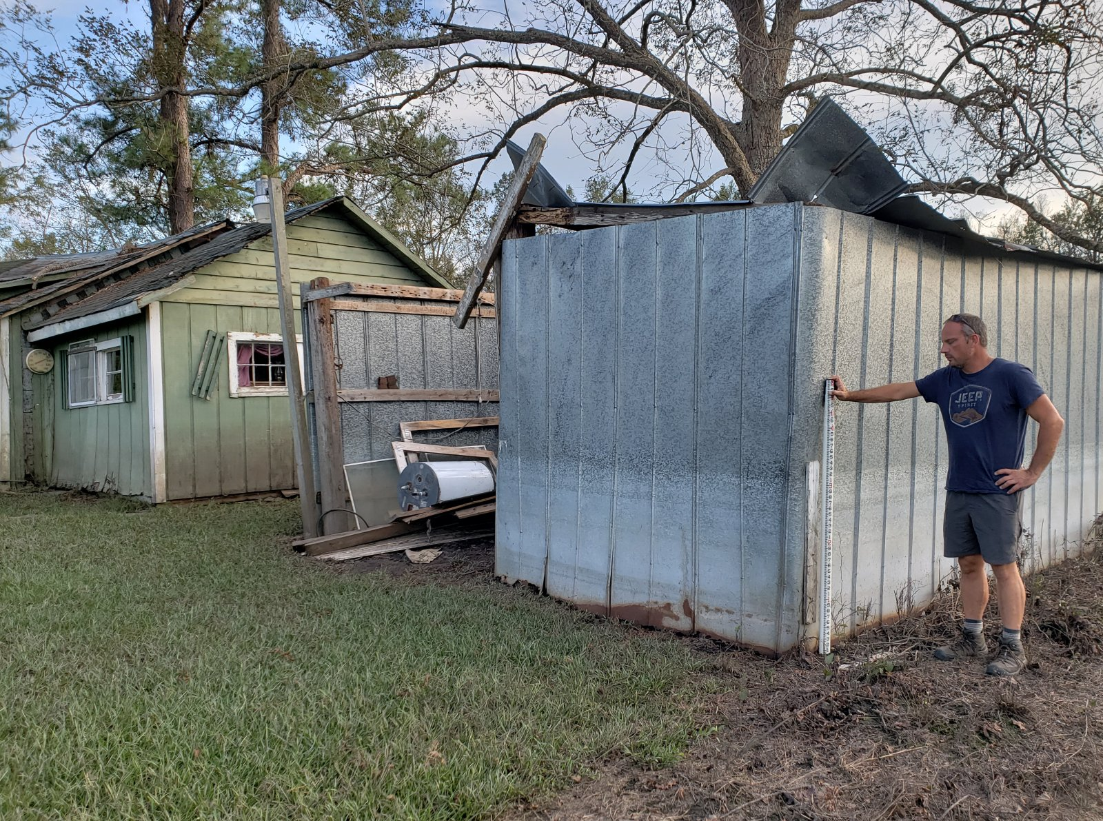 Widespread flooding occurred in the Crusoe Island community near the Brunswick/Columbus County line. Here a high water mark is being surveyed over three feet above ground level on a metal shed.