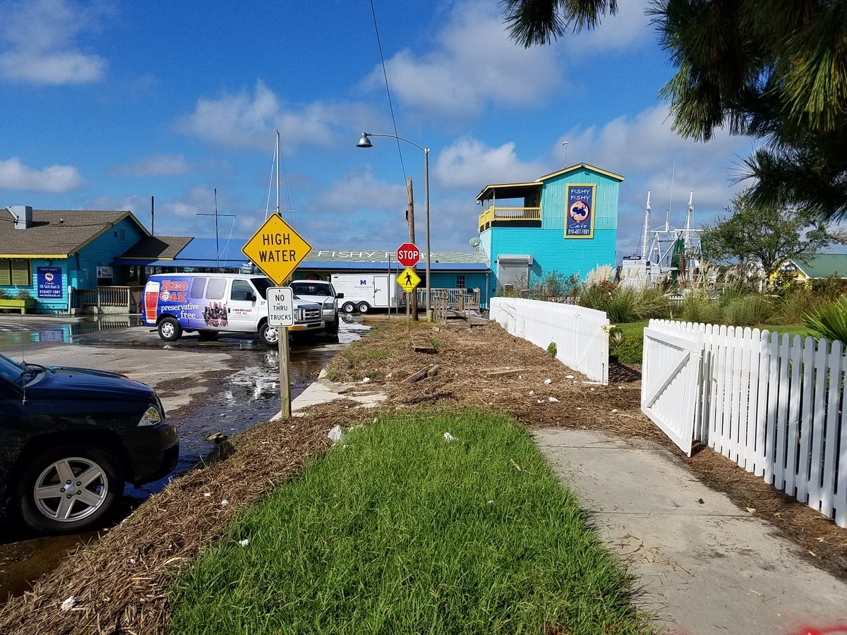 High tides during Florence deposited debris on the sidewalk at the Fishy Fishy Cafe in Southport. (Photo credit: NWS)