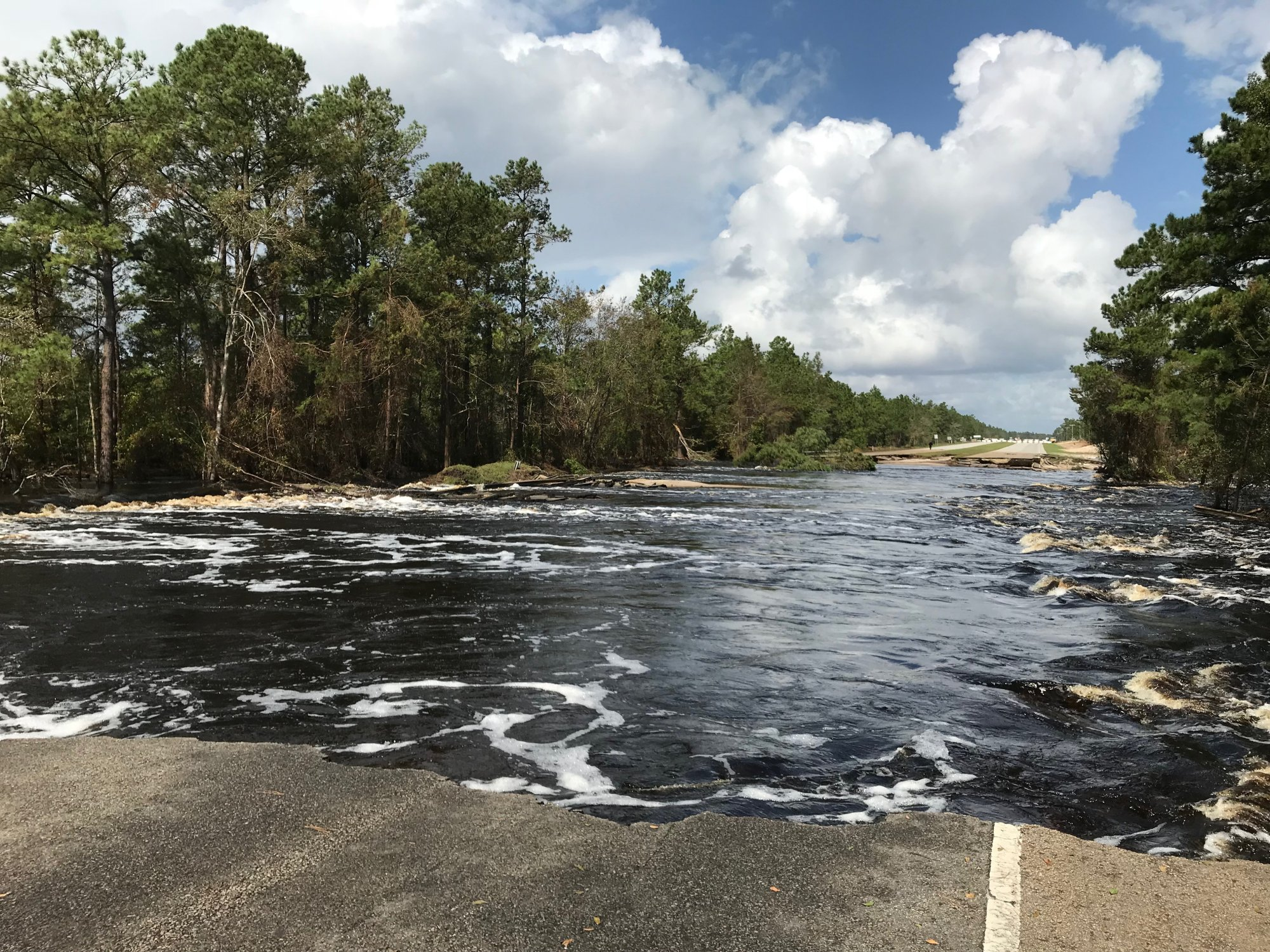 The Cape Fear River scoured out a section of US Highway 421 near the New Hanover/Pender county line.  Record-high levels on the Cape Fear allowed water to overtop the highway and flow down into the adjacent Northeast Cape Fear River basin. (Photo credit: Rick Neuherz/NWS)