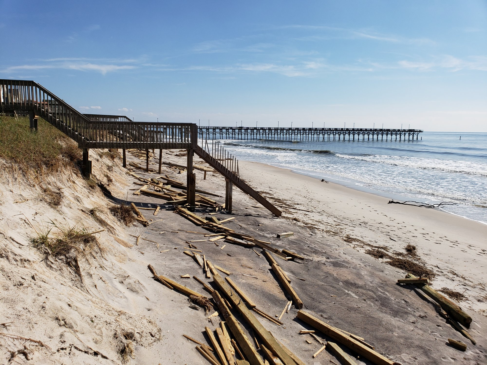 Damage to the beach at Surf City viewed from Beach Access #20. Debris like this was common along most North Carolina beaches after Hurricane Florence. (Photo credit: Carl Morgan/NWS)