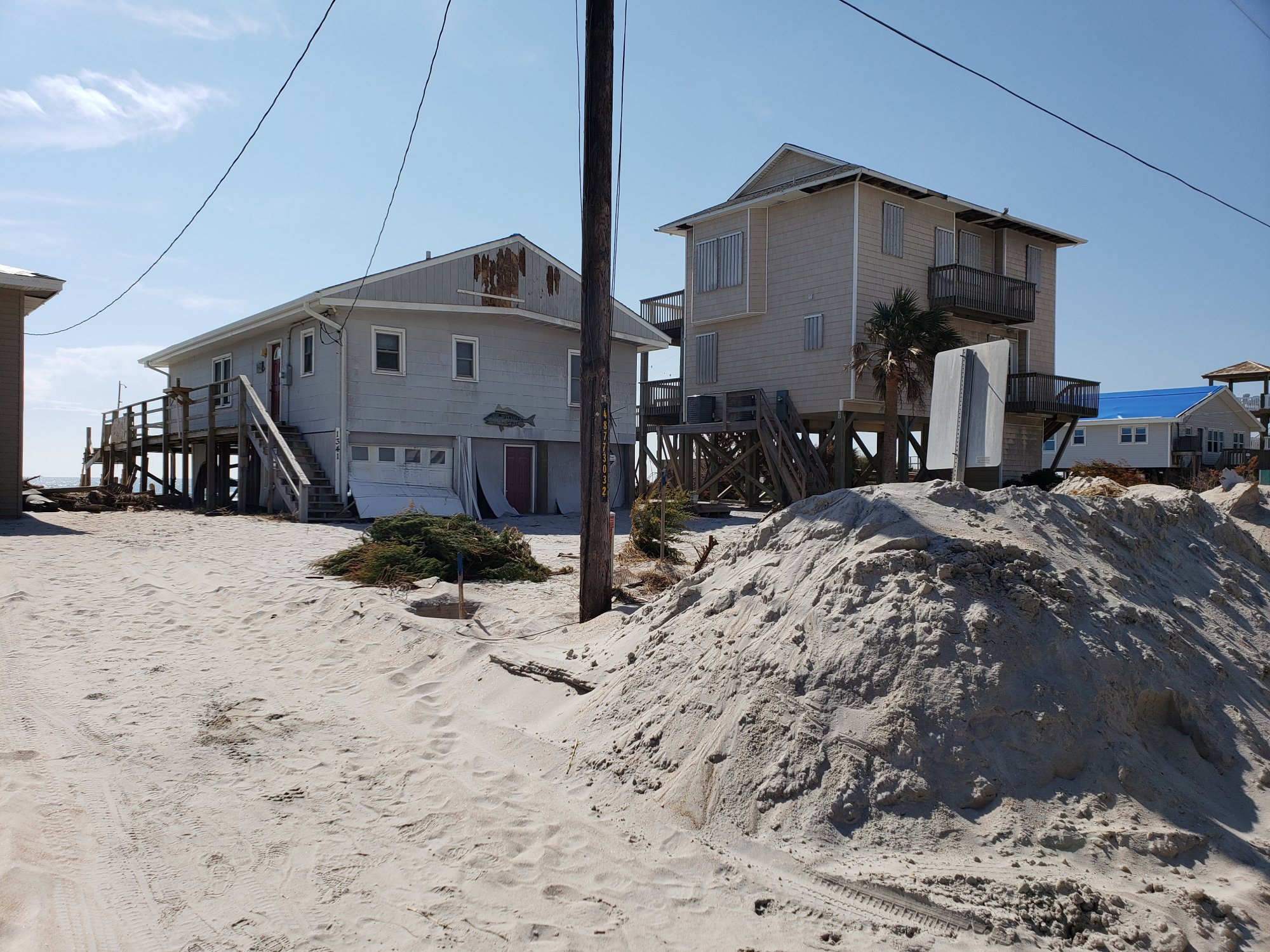 Florence's storm surge covered roads in sand, while the wind damaged siding and roofs. (Photo credit: Carl Morgan/NWS)