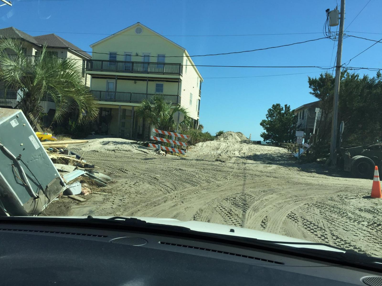 Sand and debris from Hurricane Matthew covers Pritchard Street in Pawley's Island, SC on October 13, 2016
