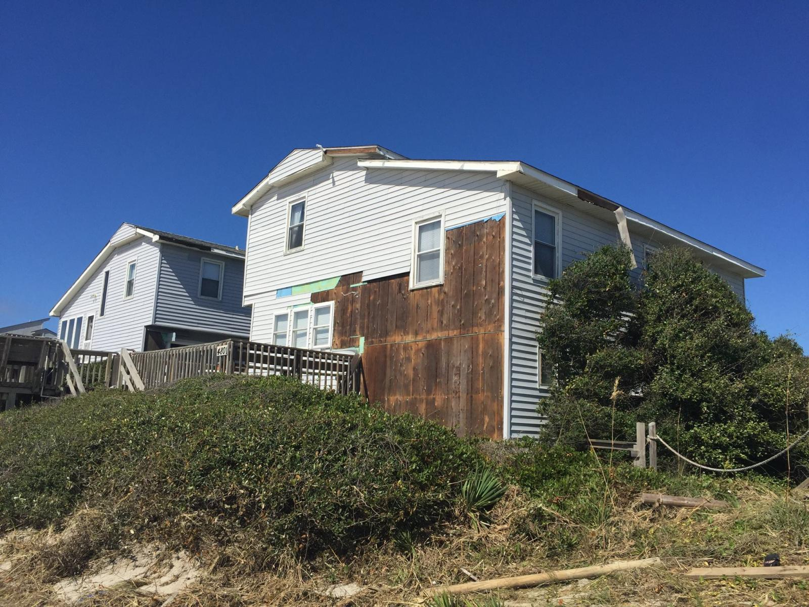 Oak Island, NC.  Siding damage to a home on West Beach Drive caused by Matthew's strong winds.