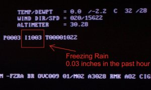 Photo of the ASOS weather display at the Wilmington NWS office during the ice storm of February 11-12, 2014.  This was the first time hourly ice accretion data was available!