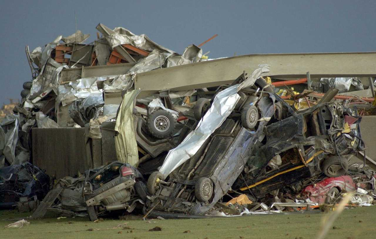 Pile of vehicles at the Parsons Plant. Photo by Steve Smedley (Bloomington Pantagraph)