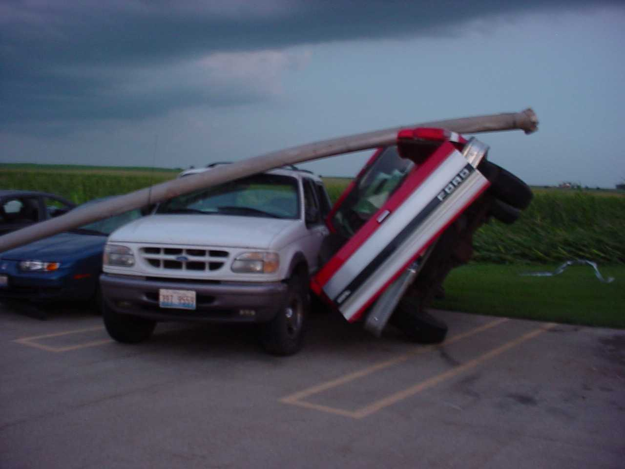 Vehicles damaged by the tornado. Photo by Jason Malson