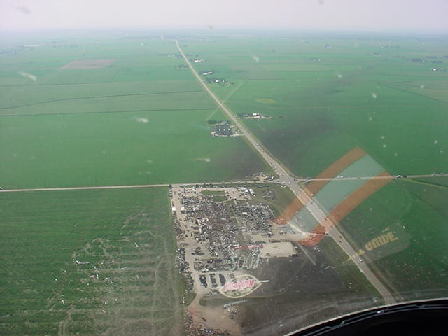 Remains of the plant seen from the air.  The track of the tornado coming in from the northwest is shown by the dark areas in the fields. Photo by Woodford County ESDA