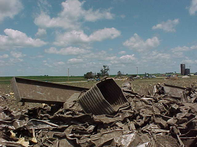 An I-beam and a steel equipment bucket were thrown over 1/2 mile by the tornado.