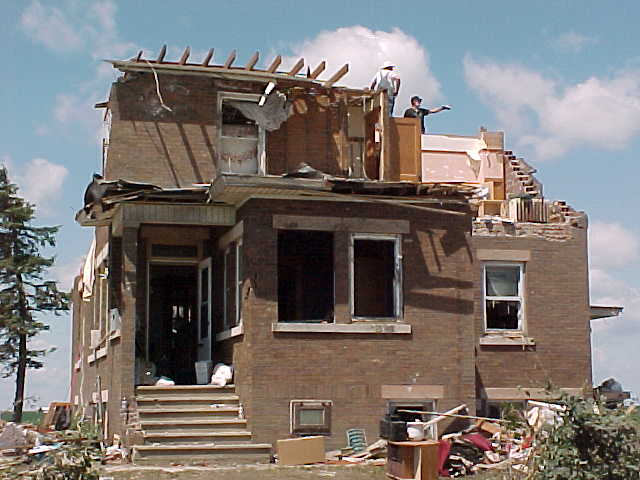 Much of the top half of this house was severely damaged by the tornado.