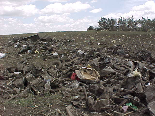 Debris from the Parsons plant was lined up in a farm field about a half mile east of the plant.