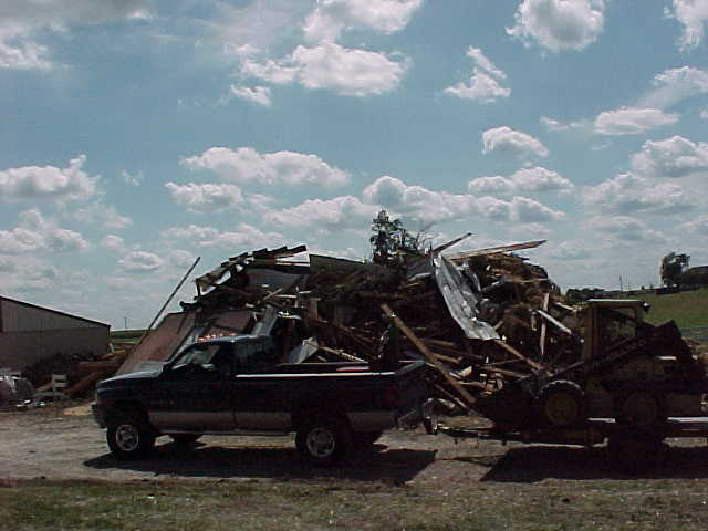 An outbuilding is demolished by the tornado.