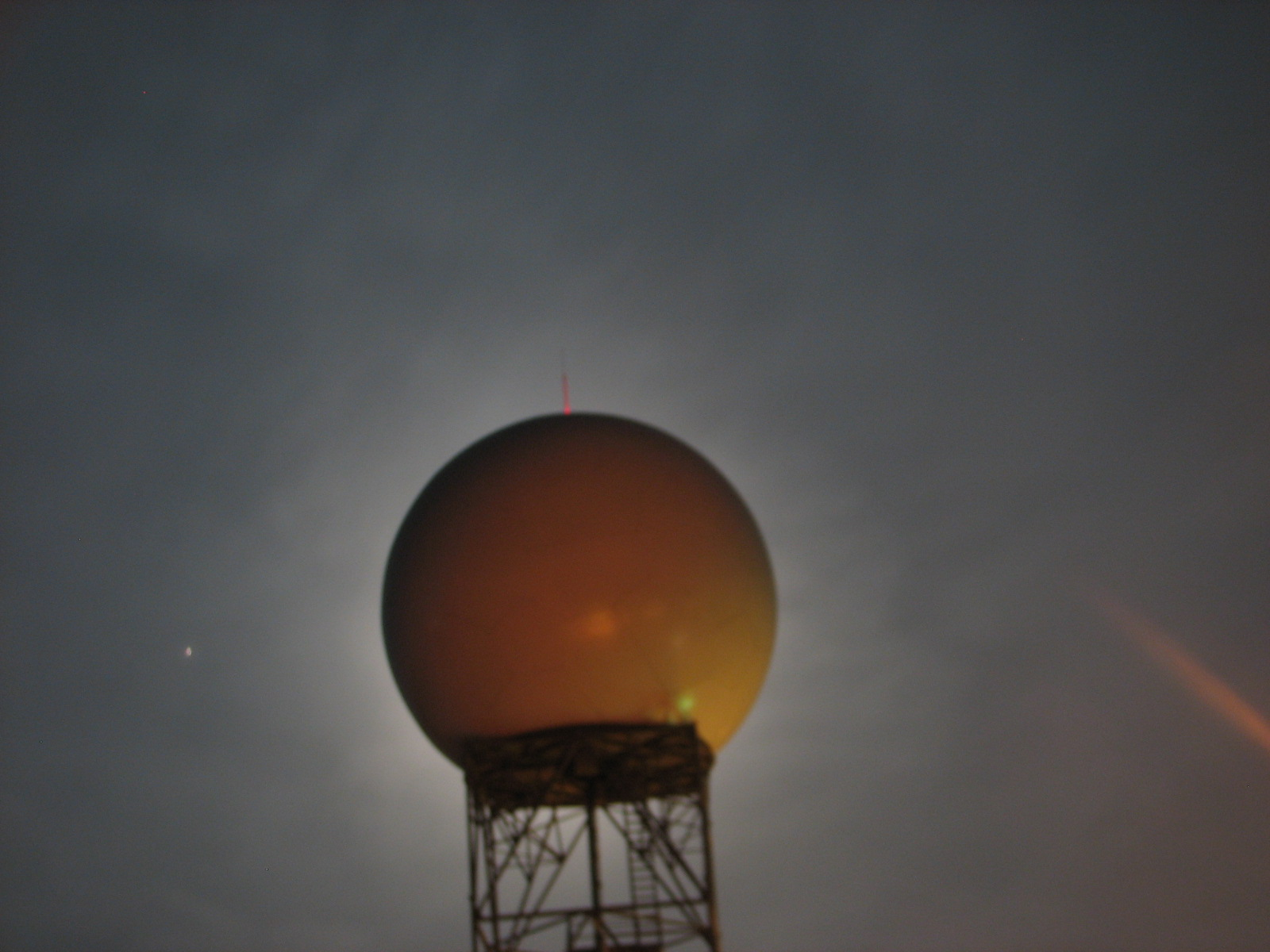 Wolf Moon directly behind radome of NWS Northern Indiana WSR-88D. The planet Mars can be seen directly to the left of the radome.