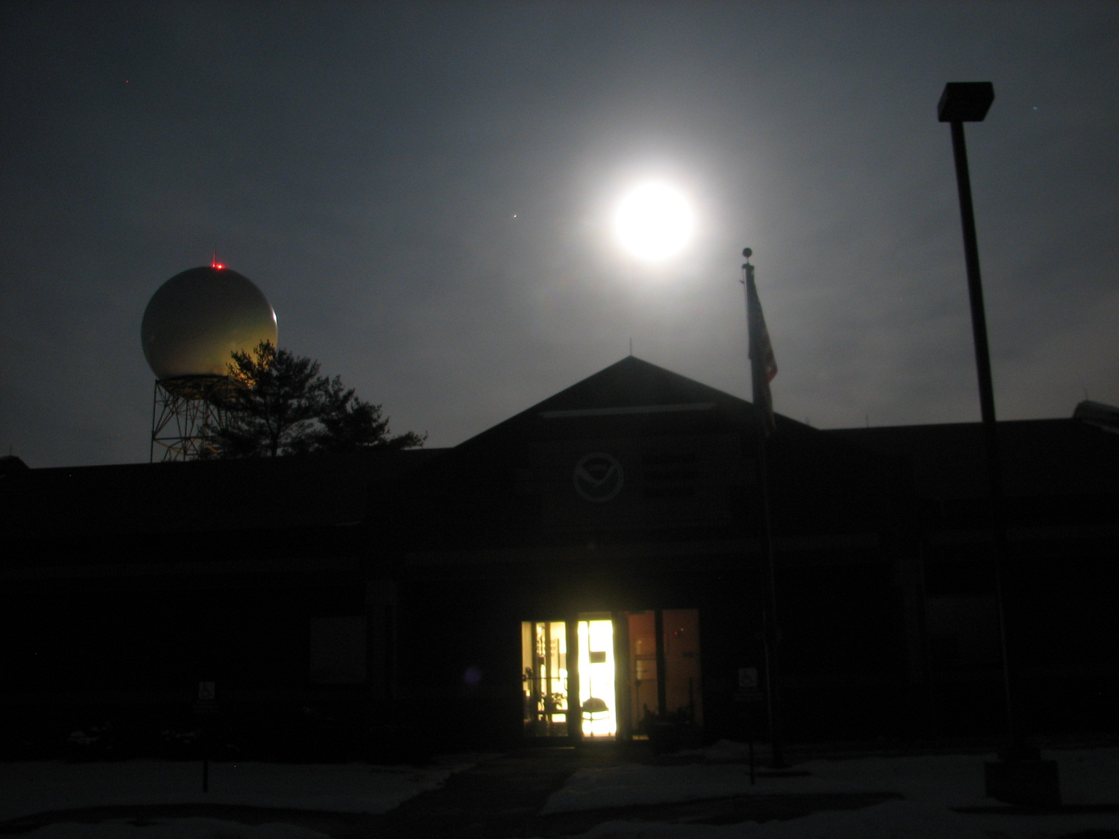 Wolf Moon directly over NWS Northern Indiana office. WSR-88D radar to the left.