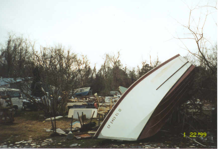 Mobile home debris and boat strewn by the tornado
