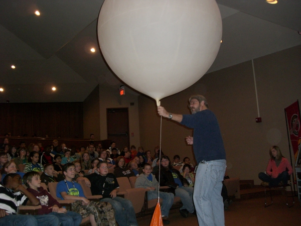 Todd Mogged explains about the radiosonde and upper air balloon.
