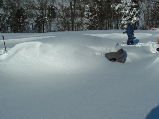 Car buried under nearly three feet of snow in Milltown, Indiana