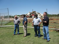 LaMarre, NWS Lubbock Warning Coordination Meteorologist, reviews damage survey information with local officials following a tornado impact in Childress, TX on May 10, 2006.