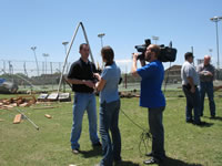 Brian LaMarre, NWS Lubbock Warning Coordination Meteorologist, conducts an interview to highlight damage survey information with ABC's KVII Amarillo News following a tornado impact in Childress, TX on May 10, 2006.