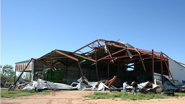 Damage to the Star Route Cotton Gin by a tornado Friday night. (picture taken by Todd Lindley, NWS Lubbock).