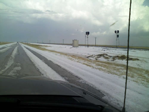 Image of hail taken on Highway 60 between Friona and Bovina around 4:30 pm on 23 April 2008. Picture courtesy of KVII and Coty Ivey. Click on the image for a larger view.