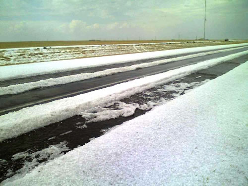 Image of hail taken on Highway 60 between Friona and Bovina around 4:30 pm on 23 April 2008. Picture courtesy of KVII and Coty Ivey.Click on the image for a larger view.