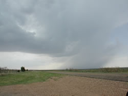 Picture of a storm located west of Roaring Springs on 27 May 2008. The image was taken just west of Roaring Springs, looking westward. Click on the image for a larger view. Photo by Gary Skwira.