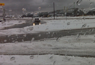 A view of the piles of hail at an intersection in Tulia