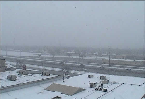 Very large snowflakes falling at the Science Spectrum (southern Lubbock) during the early afternoon of February 11, 2010. Click on the image for a larger view.