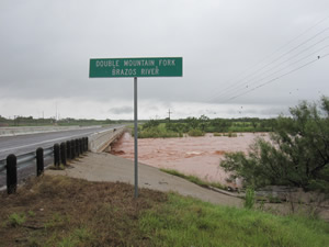 The swollen Double Mountain fork of the Brazos flowing under the bridge near Justiceburg