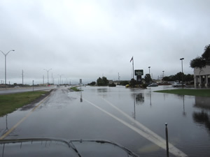 View of flooding along the access road of south Loop 289 - click to enlarge the image