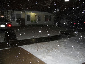 Photo of snow falling at Tech Terrace in Lubbock
