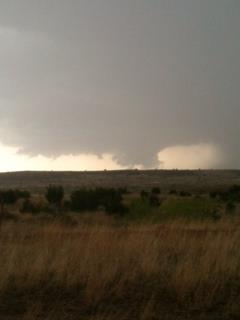 Pictures of a wall cloud captured on a storm that moved southwest of Guthrie during the evening of May 8, 2013. The picture is courtesy of David Purkiss. Click on the image for a larger view.