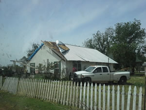 Photograph of roof damage that occurred in Girard. Click on the image for a larger view.