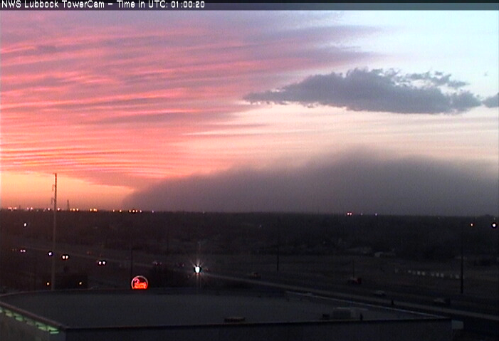 Wall of dust, along a strong cold front, approaching Lubbock around 8 pm on 11 March 2014.