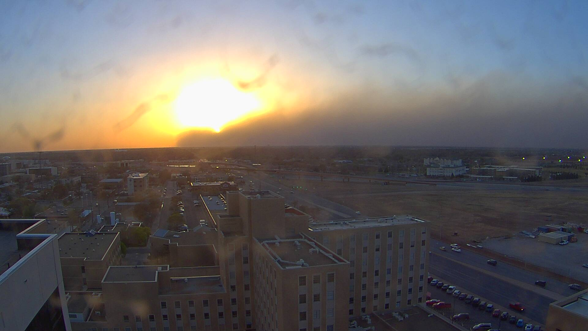 "One more view of the cold front and ""wall"" of dust moving through Lubbock near sunset on April 3rd. This picture is looking west from Covenant Hospital. The image is courtesy of KAMC."
