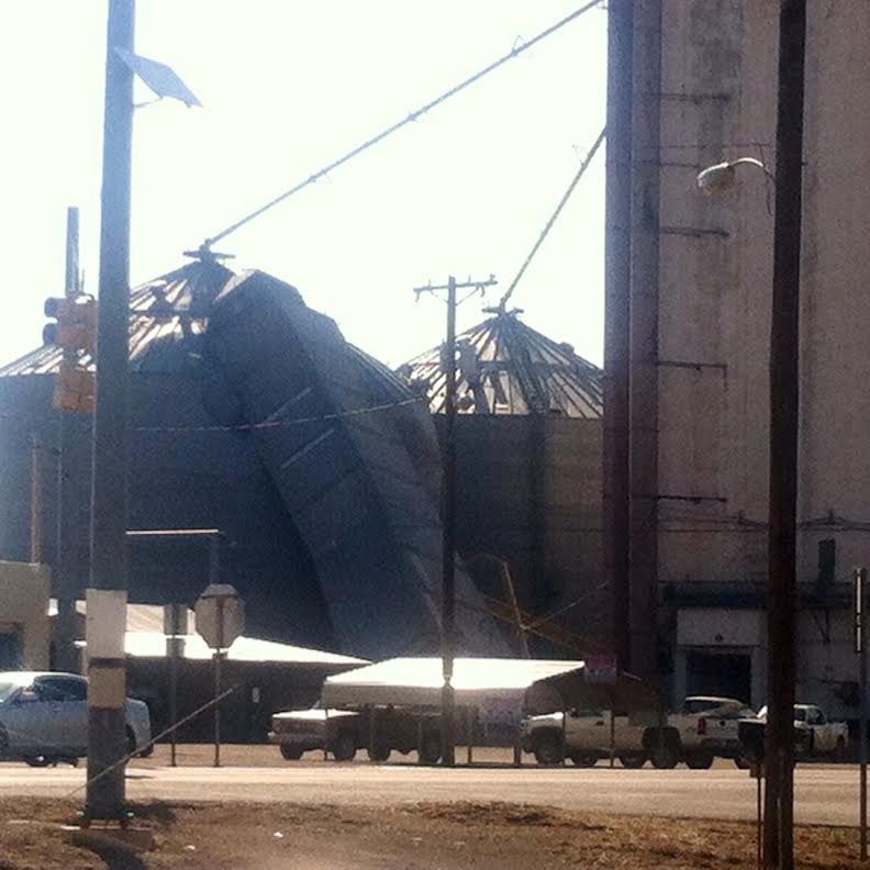 The storms on 21 May 2014 produced strong downburst winds, that cause isolated damage around the region. Pictured here is a free standing grain elevator that was blown against a grain tank in Hart during the evening of the 21st. The picture is courtesy of Randy Griffitt.
