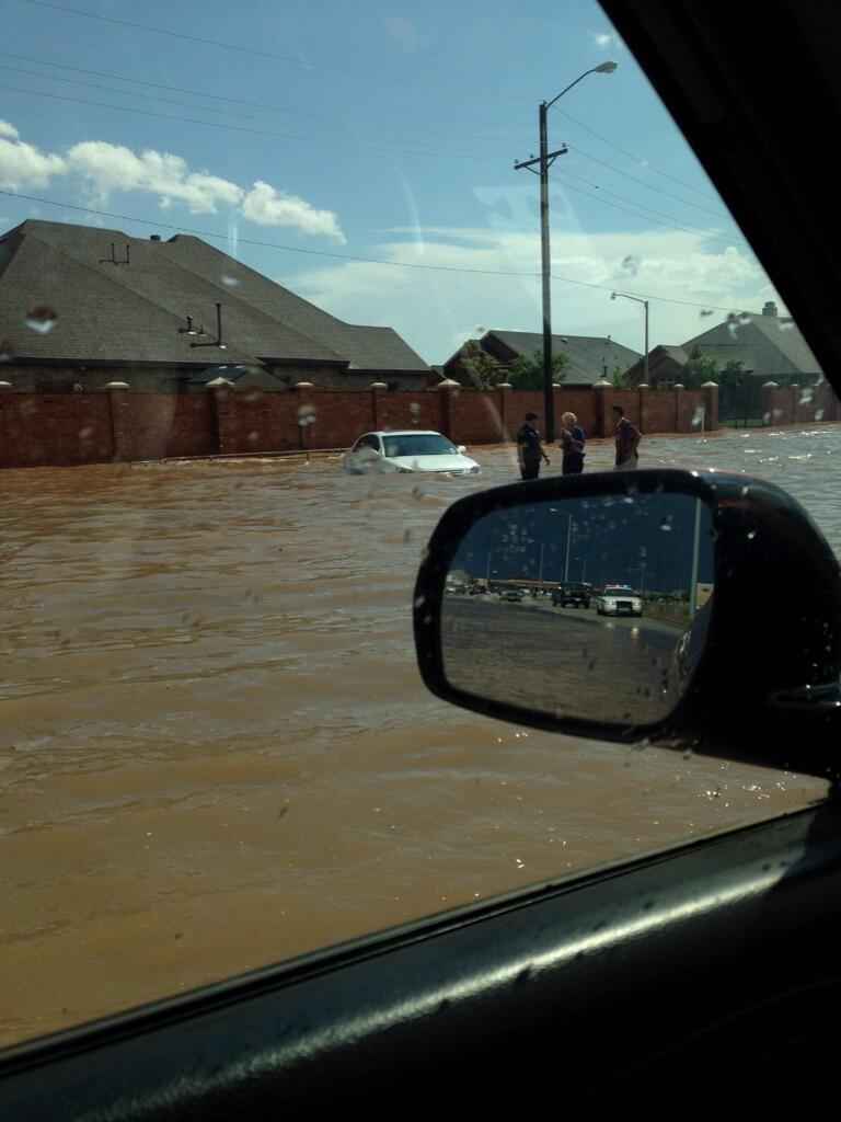 The heavy rain caused flooding around the region. This image shows a flooded car near 98th and Indiana, in Lubbock, on Memorial Day afternoon (Monday, 26 May 2014). The image is courtesy of Cortney (@cenorty) via Twitter.