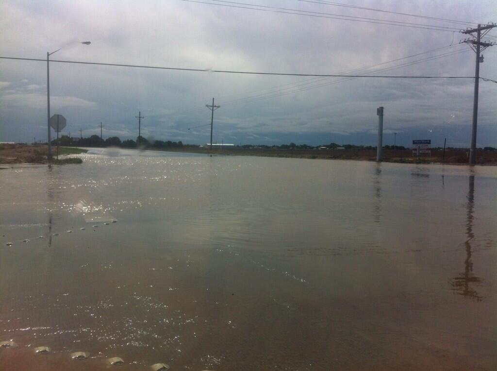 The heavy rain caused flooding around the region. Thist picture, courtesy of Aaron Hill, shows water inundating the intersection of FM 114 and Frankford Avenue, in Lubbock County, Sunday morning (25 May 2014).
