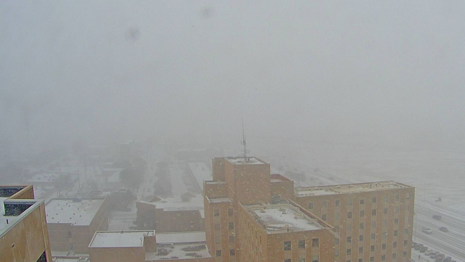 Moderate to heavy snow affecting Lubbock during the early afternoon on Wednesday, March 4th. The image was captured from Covenant Hospital and is courtesy of KAMC.