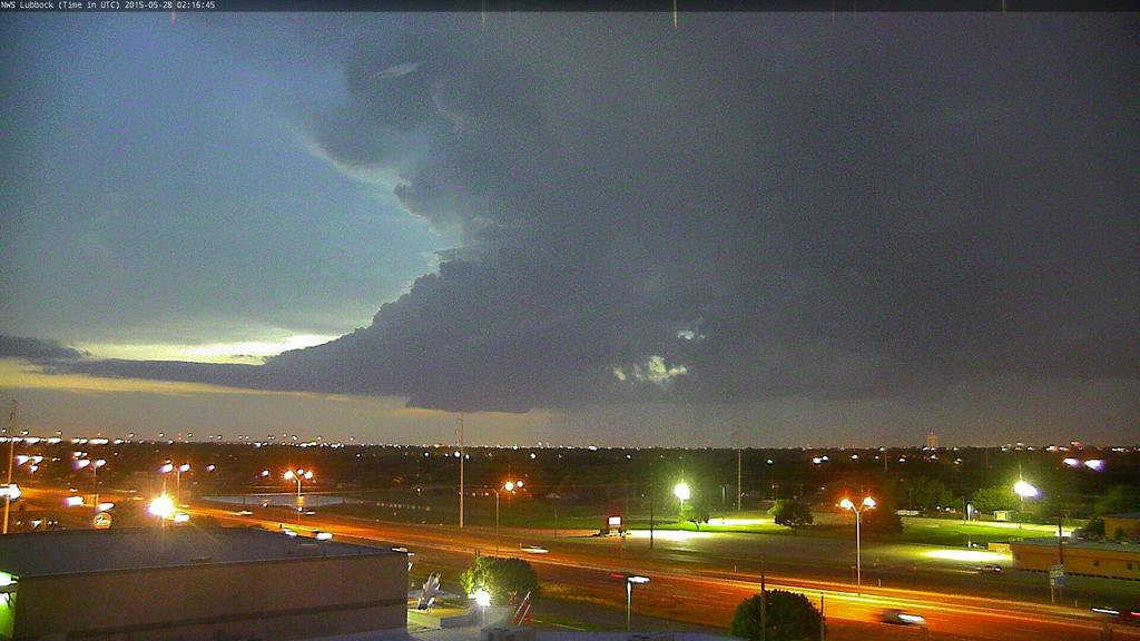 The right picture shows a developing storm and wall cloud, viewed from south Lubbock (looking northwest), Wednesday evening.