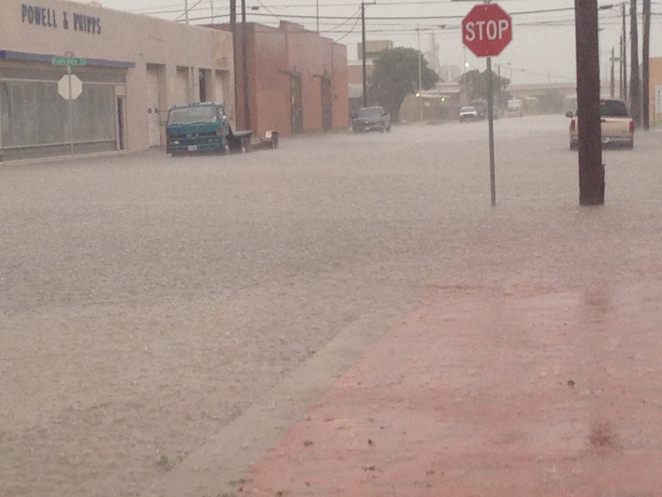 Image of heavy rain and flooding in downtown Lubbock on Thursday, 28 May 2015. The picture is courtesy of KCBD.