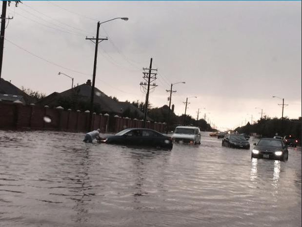 Flooding problems near 98th and Quaker in Lubbock around 6:45 pm on 6 July 2015.