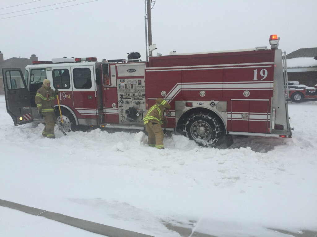 Fire truck being dug out on the Lubbock streets. Image is courtesy of the Lubbock Fire Department.