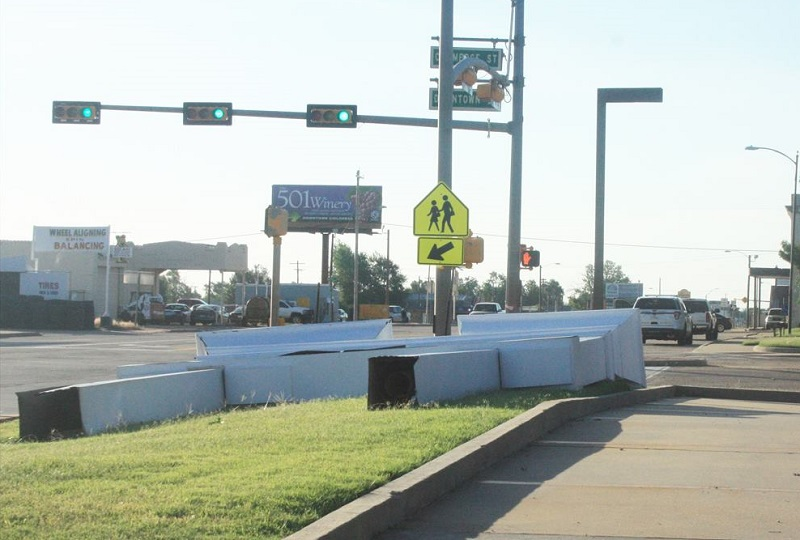 A bank sign blown over in Childress