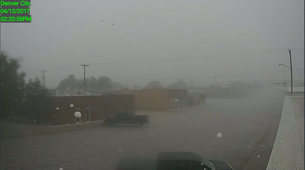 Heavy rain and large hail falling in Denver City at 2:21 pm on Wednesday. The picture is courtesy of KAMC.