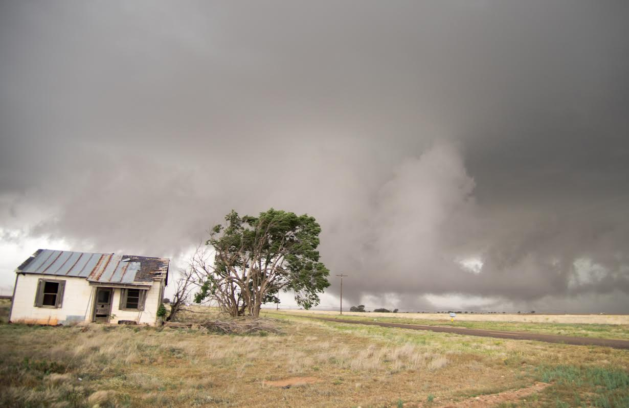 Storm clouds approaching an old homestead on the western South Plains Tuesday evening (courtesy of Mark Conder).