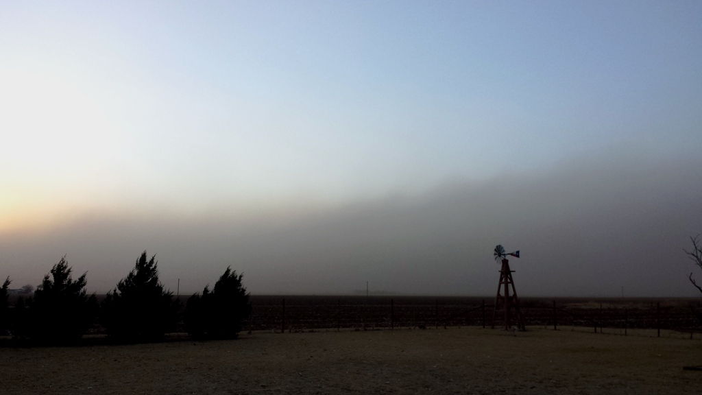 Picture of the dust along a cold front approaching the Ropesville during the evening of 18 March 2018. The image is courtesy of Wes Burgett.