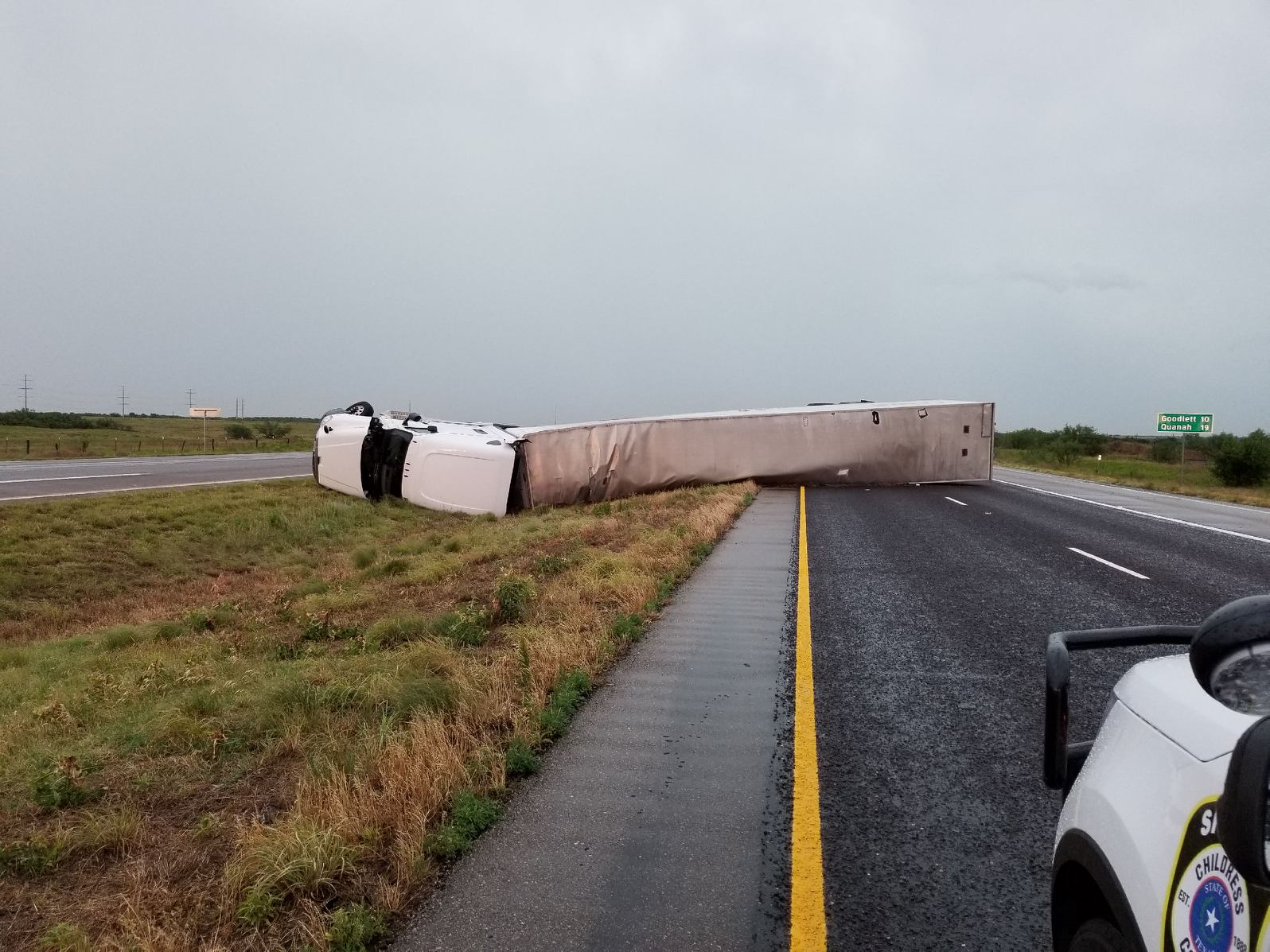 Tractor trailer blown over near Kirkland, on Highway 287, on the evening of 7 June 2018.
