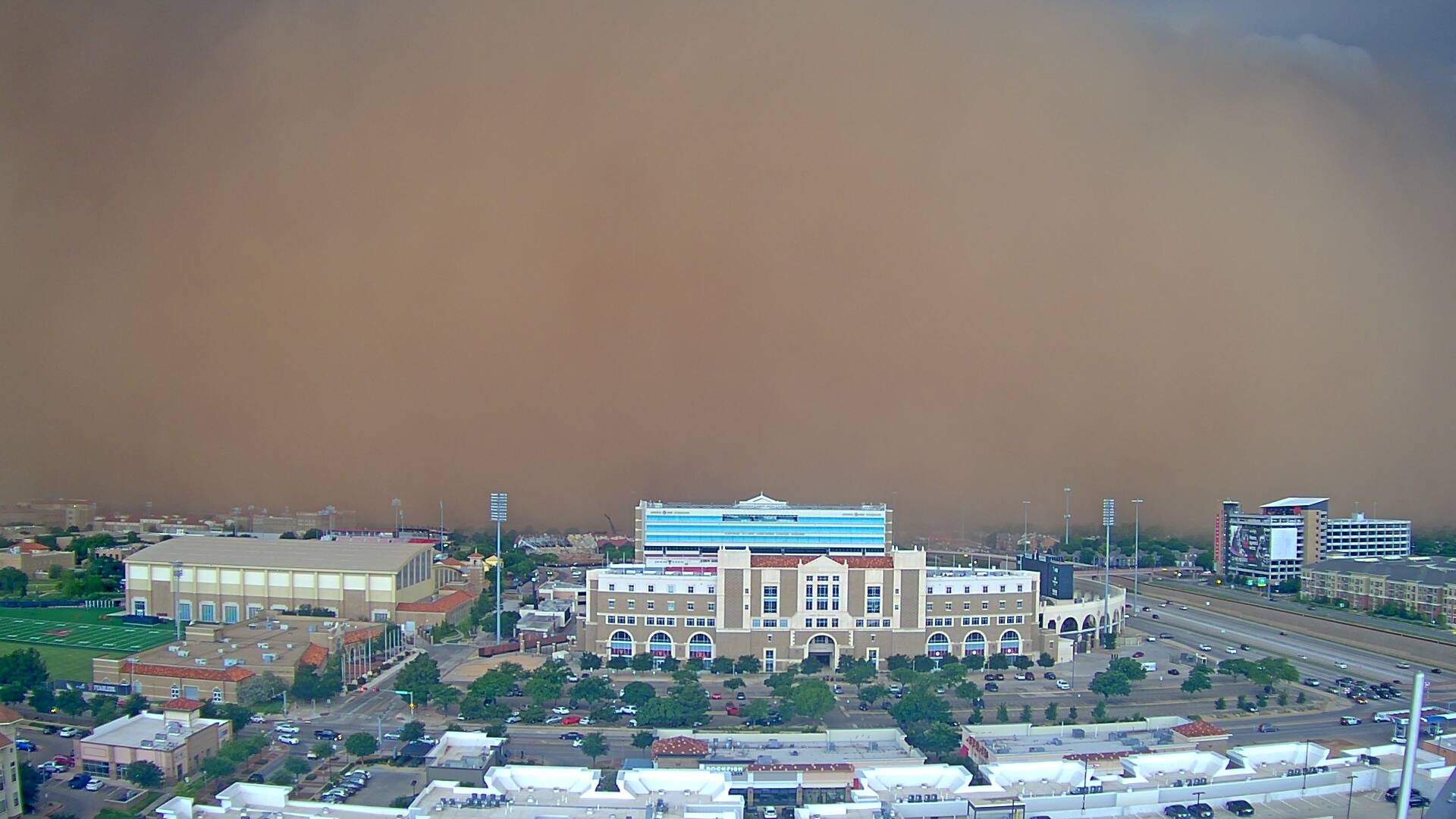 A wall of wind and dust about to engulf Jones AT&T Stadium on the Texas Tech Campus. The picture was taken at 6:13 pm on 5 June 2019. The image is courtesy of KAMC.